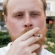 Footage of Red Bearded Hipster Man Looking in Camera and Smoking Cigarette - VideoHive Item for Sale