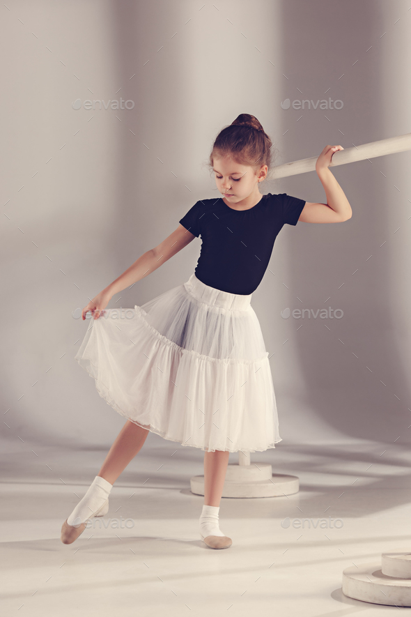 The little balerina dancer on gray background - Stock Photo - Images