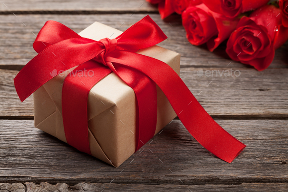 Valentines day greeting card with roses and gift - Stock Photo - Images