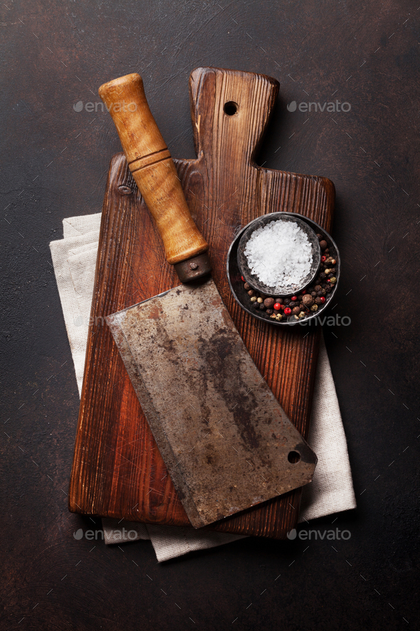 Butcher. Vintage meat knife and spices - Stock Photo - Images