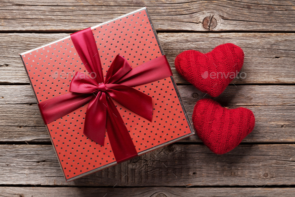Valentines day gift box with red hearts - Stock Photo - Images