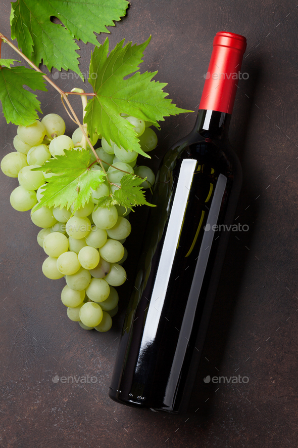 Wine bottle and grapes - Stock Photo - Images