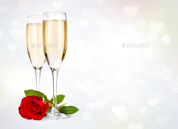 Two champagne glasses and rose - Stock Photo - Images