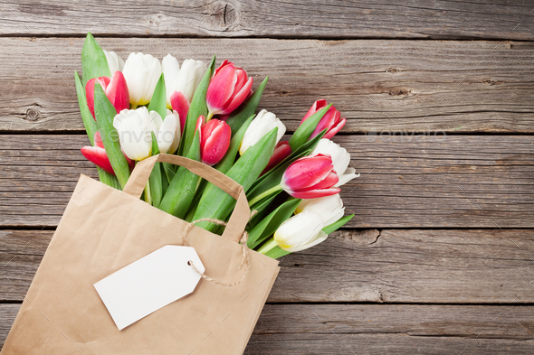 Colorful tulips in paper bag - Stock Photo - Images