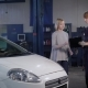 Professional Mechanic Gives the Customer a Car That Was Repaired in a Car Workshop