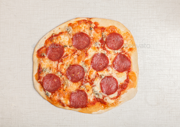 tasty delicious pizza pepperoni on white table, top view - Stock Photo - Images