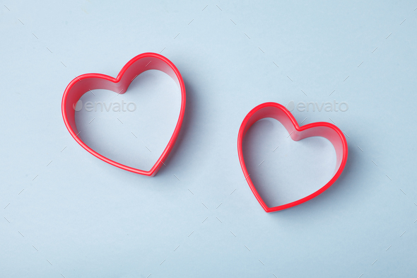 red heart symbol on blue background - Stock Photo - Images