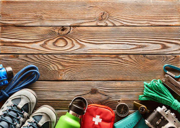 Travel items for hiking over wooden background - Stock Photo - Images