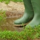 Feet in Rubber Boots Fun To Jump Across the Puddle - VideoHive Item for Sale