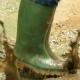 Rubber Boots Jumping Over Dirty Puddles - VideoHive Item for Sale