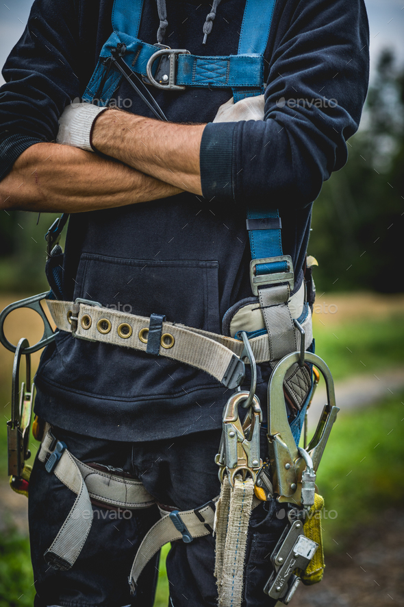 Unrecognizable technician with harness - Stock Photo - Images