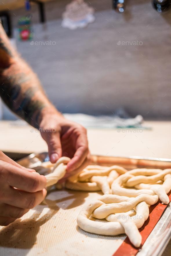 Crop unrecognizable person preparing pretzels. - Stock Photo - Images