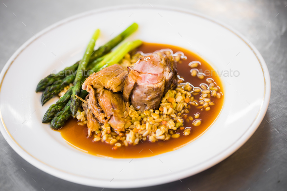 Cooked meat with asparagus - Stock Photo - Images