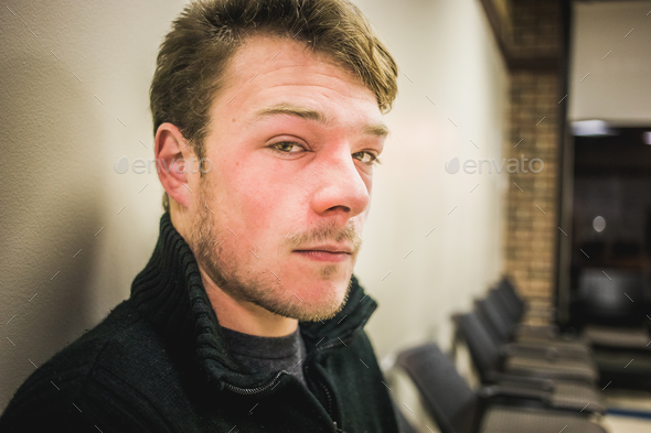Swolleing Allergic Reaction of a Young Adult in the Waiting Room - Stock Photo - Images