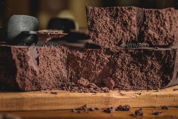 Close-up of Big Chocolate Block and knife. - Stock Photo - Images
