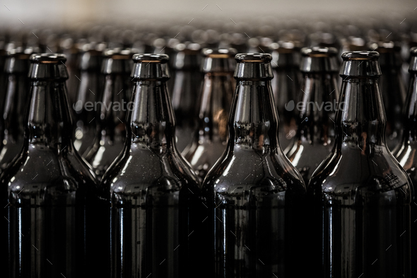 Brown glass bottles rows - Stock Photo - Images