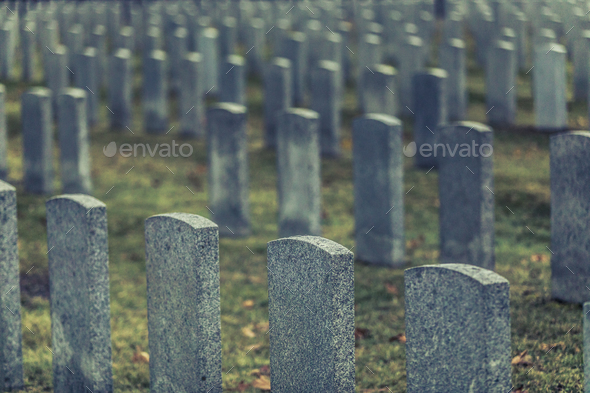 Back of Army Headstone and Graveyard Cemetery during a Sad Day o - Stock Photo - Images