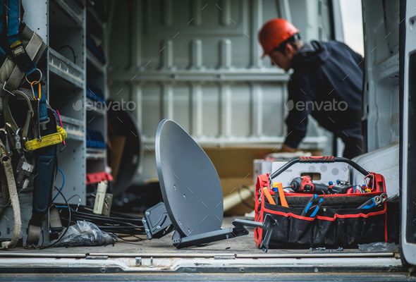 Young technician and van with satellite antenna. - Stock Photo - Images