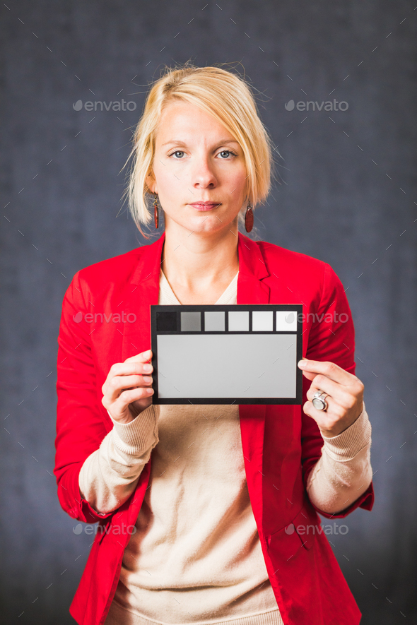 Woman holding gray color board - Stock Photo - Images
