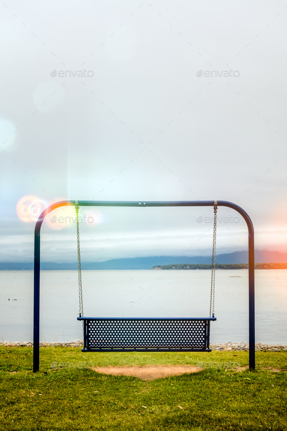 View to swings placed at ocean shore in Gaspe, New-Richmond, Que - Stock Photo - Images