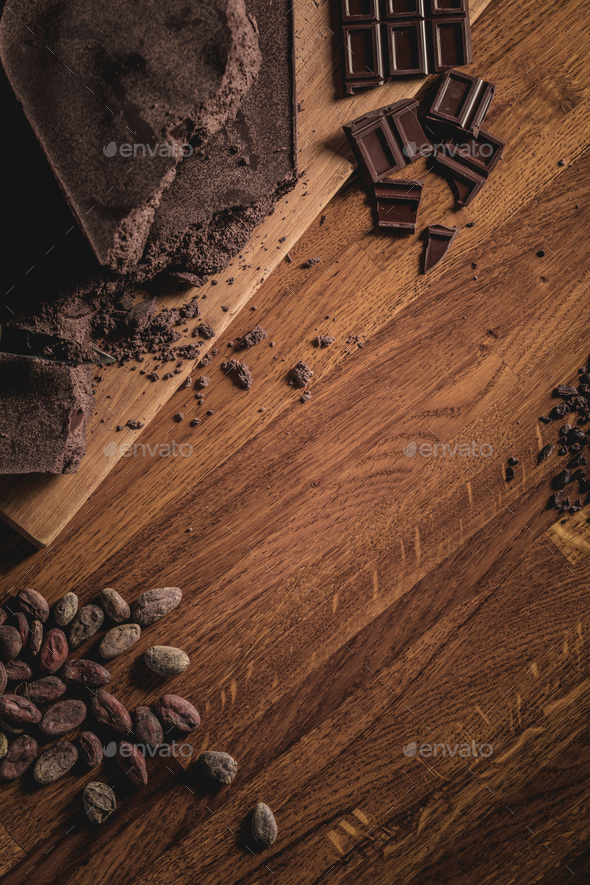 Sweet Table Top View arrangement of Cocoa beans, nibs and Chocol - Stock Photo - Images