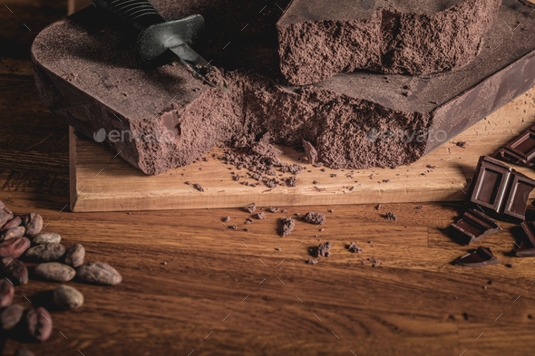 Arrangement of Cocoa beans, nibs and Chocolate bars on wooden su - Stock Photo - Images