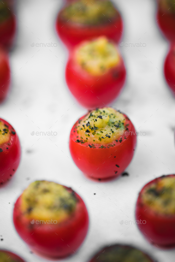 Tomatoes with cheese snacks - Stock Photo - Images