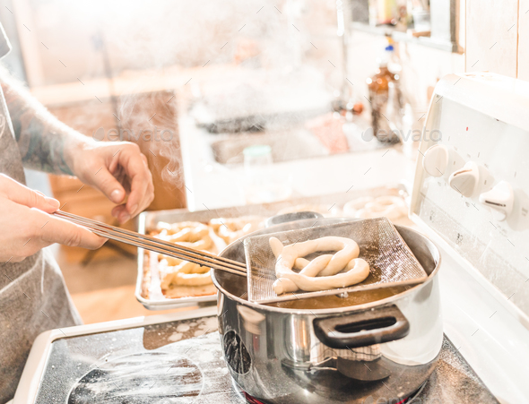 Pretzel being prepared and parboiled in Boiling Water. - Stock Photo - Images