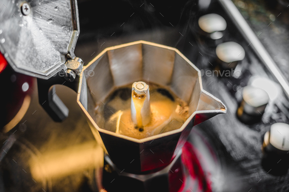 Italian Aluminum Coffee Maker Brewing a Fresh Dark Coffee on the - Stock Photo - Images