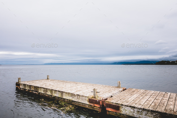 Wooden pier at ocean in cloudy day in Gaspe. - Stock Photo - Images