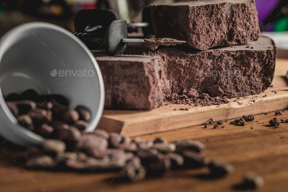 Sweet arrangement of cocoa beans and chocolate bars on table - Stock Photo - Images