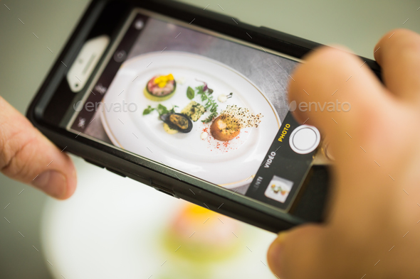 Person shooting plate with seafood - Stock Photo - Images