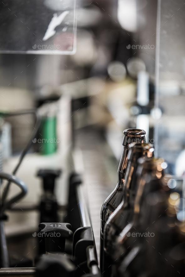 Dark bottles on conveyor - Stock Photo - Images