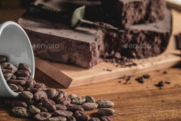 Sweet arrangement of cocoa beans and chocolate bars - Stock Photo - Images