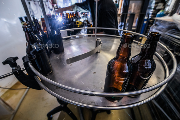Beer bottles on conveyor - Stock Photo - Images