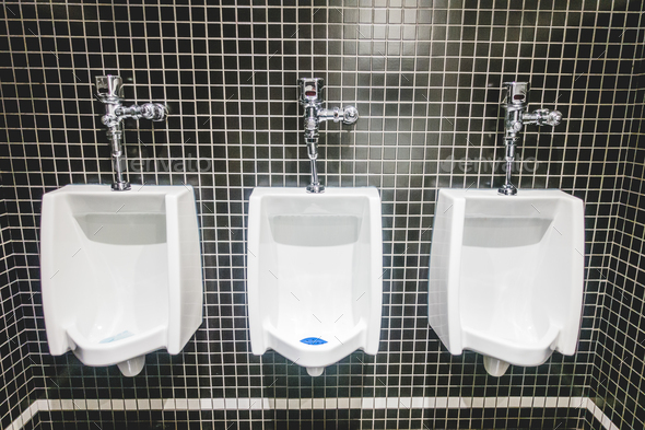 White Urinal on Back Tiles Wall - Stock Photo - Images