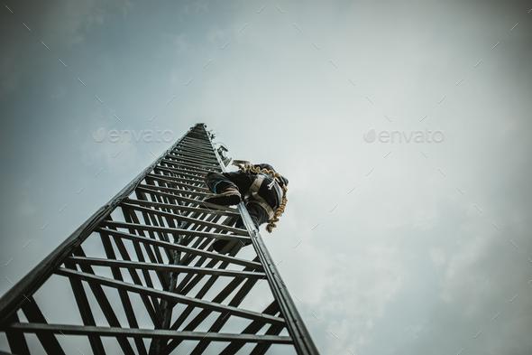 Telecom Worker Climbing Antenna Tower - Stock Photo - Images