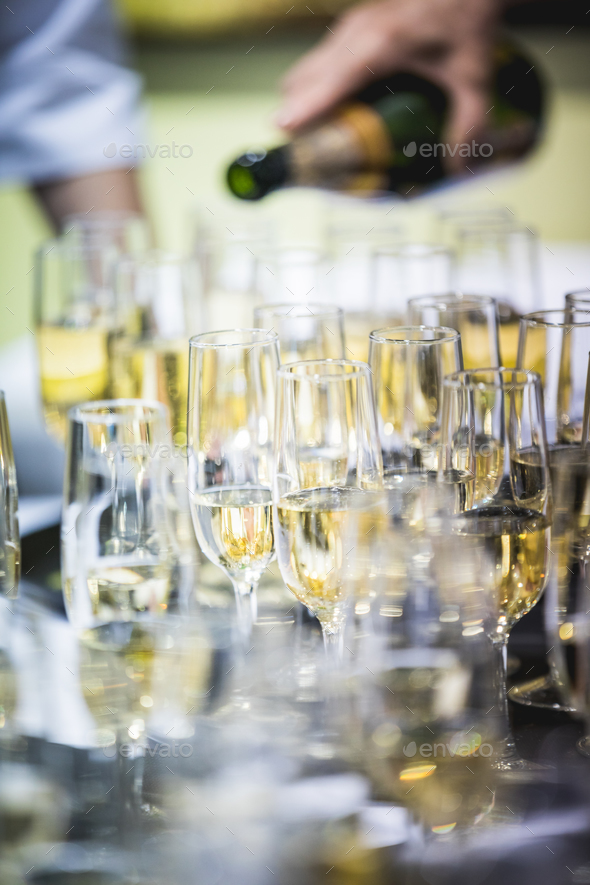 Waiters pouring champagne - Stock Photo - Images