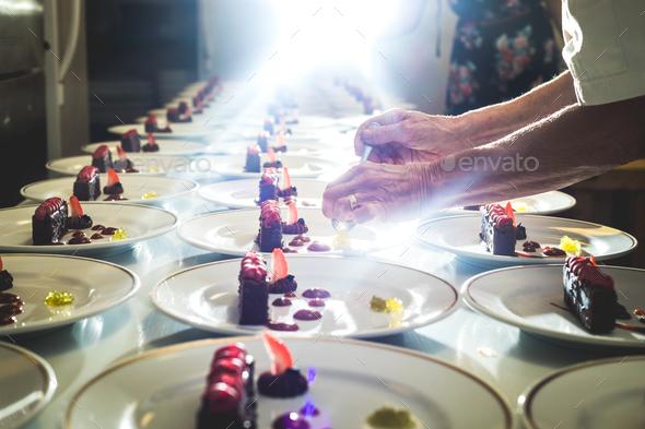 Crop cook serving desserts - Stock Photo - Images