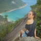 Girl Enjoy Picturesque View of the Island at a Height, Smiling on Camera - VideoHive Item for Sale