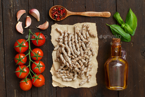 Whole wheat pasta, vegetables, herbs and olive oil - Stock Photo - Images