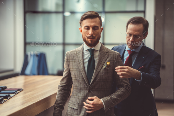 Tailor and customer - Stock Photo - Images