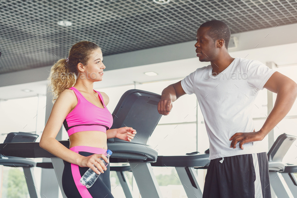 Handsome young man and beautiful woman after training - Stock Photo - Images