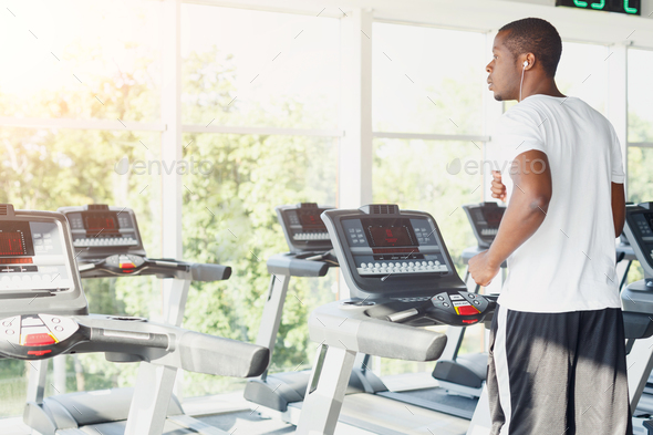Man on treadmill in fitness club, healthy lifestyle - Stock Photo - Images