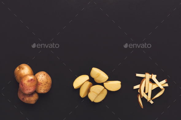Whole and cut potato on black isolated background - Stock Photo - Images