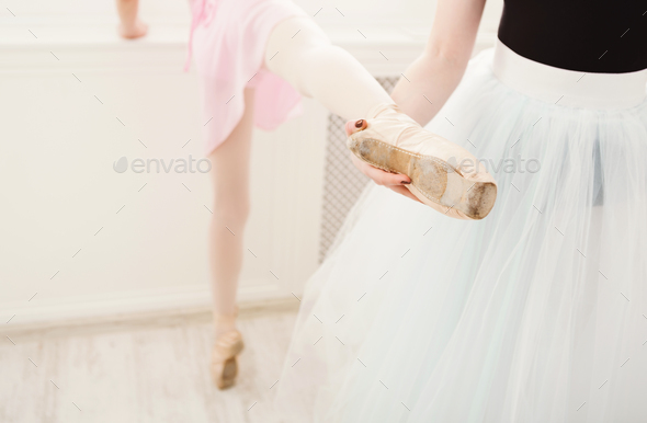 Teacher helping her student during dance class - Stock Photo - Images