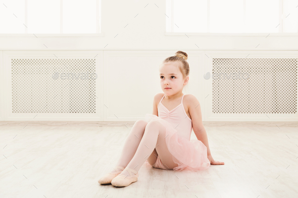 Portrait of little ballerina on floor, copy space - Stock Photo - Images