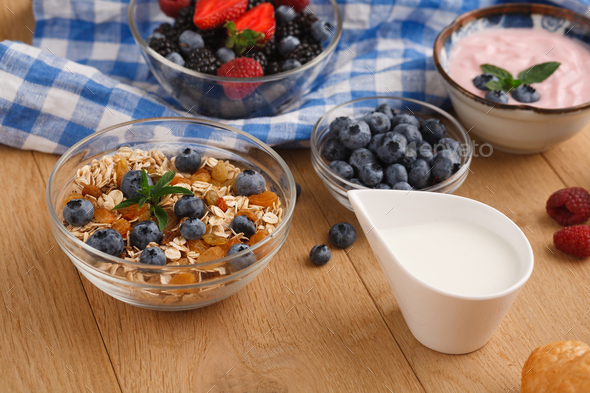 Rich breakfast on natural wooden table - Stock Photo - Images