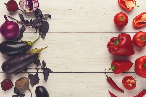 Border of various red and violet vegetables on white wood - Stock Photo - Images