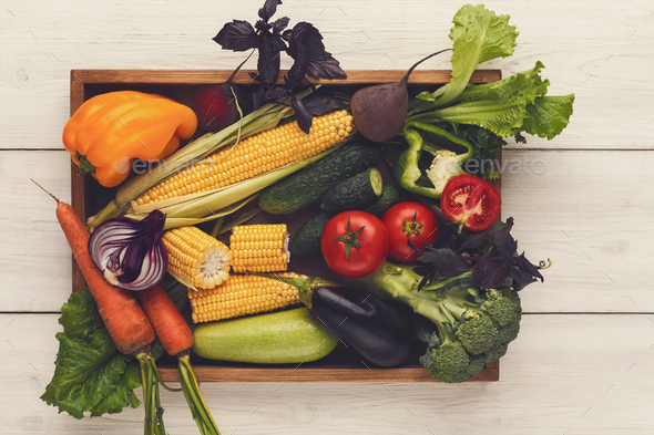 Plenty of fresh vegetables on wooden background with copy space - Stock Photo - Images